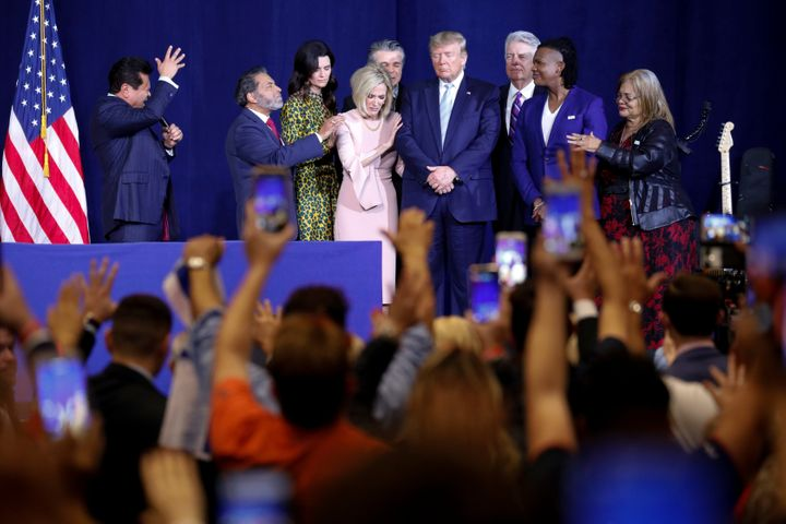 Guillermo Maldonado (left) and other evangelical leaders pray for President Donald Trump at an evangelical rally in Miami on