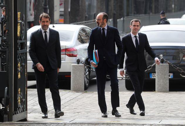 Christophe Castaner, Édouard Philippe et Olivier Véran devant le ministère de l'Intérieur...