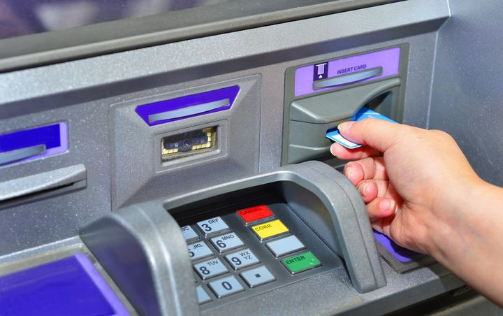 In this stock photo, a woman is seen using a bank machine. Canada's big banks say they will provide financial relief to customers impacted by the novel coronavirus.