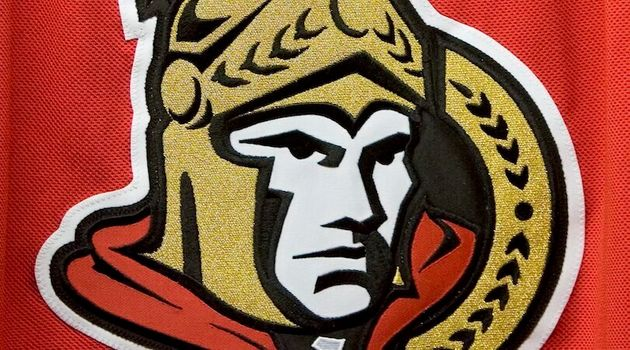 The Ottawa Senators logo is seen here on a red jersey in Ottawa on Aug. 22, 2007. The team has not named...