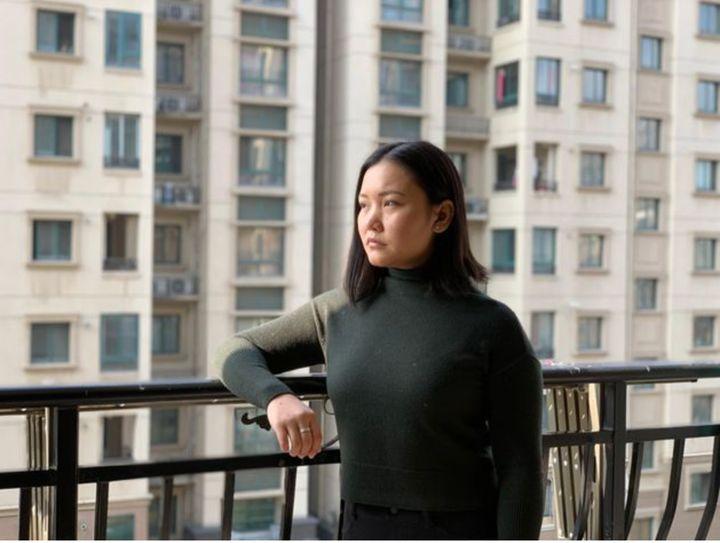 Debbie Lu on a balcony in Wuhan, China.