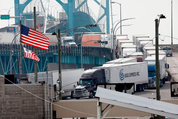 Vehicles cross at the US Customs booth at the Ambassador Bridge that connects Windsor, Canada to Detroit, Mich. on March 18, 2020 in Detroit, Mich.