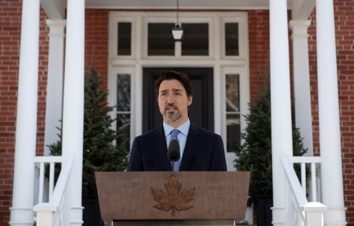 Prime Minister Justin Trudeau speaks during a news conference outside Rideau Cottage about the measures Canada is taking to combat the COVID-19 virus in Ottawa on March 18, 2020.