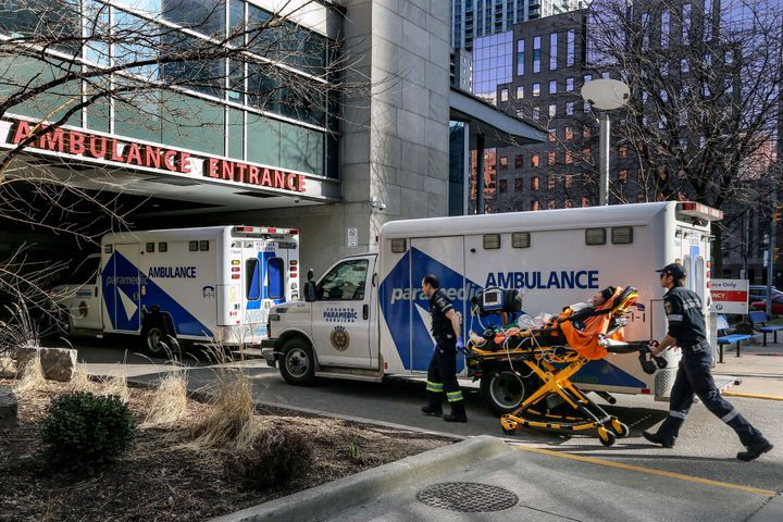 Paramedics transport a patient to the Toronto General Hospital on March 9, 2020.