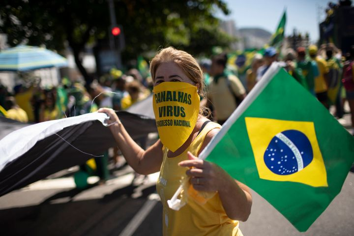 Supporters of Brazilian President Jair Bolsonaro rally on Copacabana beach in Rio de Janeiro, Brazil, on March 15, 2020.