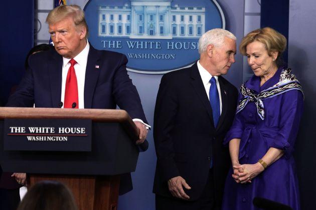 White House Coronavirus Response Coordinator Deborah Birx listens to U.S. Vice President Mike Pence as...