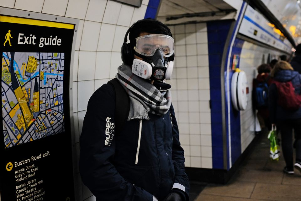 A person wearing a full face mask in King's Cross underground station in London after NHS England announced...