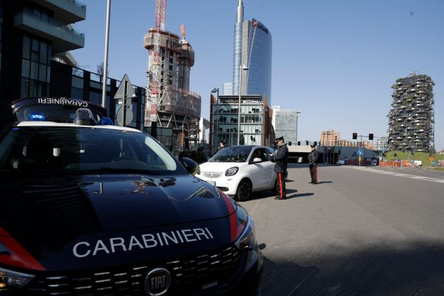 Carabinieri officers set a road block in the Porta Nuova business district in Milan, Italy, Monday, March...