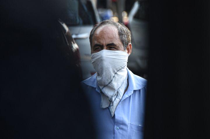 DELHI, INDIA, MARCH 19, 2020: A man wearing a hanky as a preventive measure against the COVID-19 coronavirus.