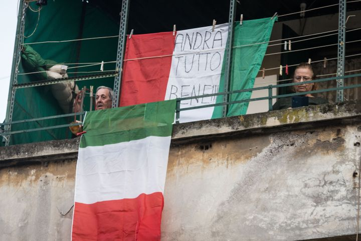 Residents on balconies in Rome.