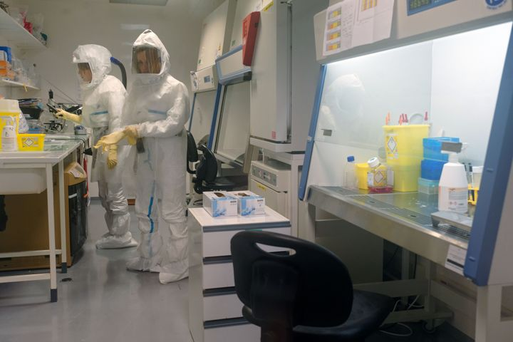 A virologist and a researcher working in a high-level biosafety security laboratory research COVID-19 at the Pasteur Institute of Lille in France on Feb. 20, 2020.