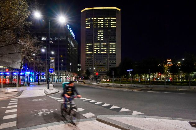 A picture taken on March 19, 2020 shows office lights of the Lombardy region headquarters, the Pirelli...
