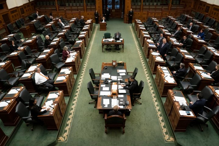 A skeleton crew of MPPs and staff attend an emergency session of Ontario's legislature on Thursday.