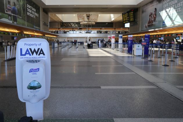 A hand sanitiser dispenser is seen at the empty international terminal at LAX airport in Los