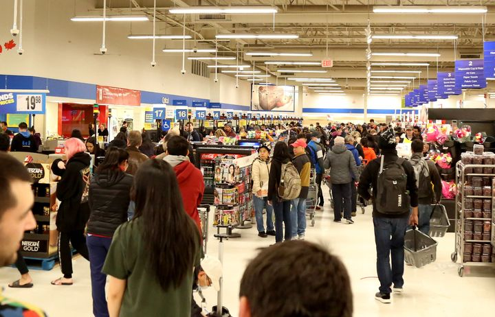 Crowds gather to buy groceries at Real Canadian Superstore in Vancouver on Monday.