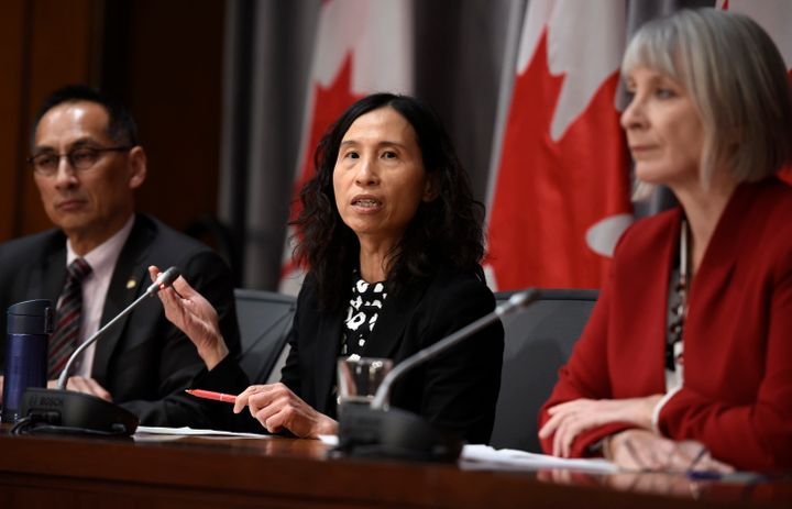 Chief Public Health Officer Dr. Theresa Tam, centre, speaks as Minister of Health Patty Hadju, right, and Deputy Chief Public Health Officer Dr. Howard Njoo, left, listen during a press conference on Parliament Hill in Ottawa on March 19, 2020.