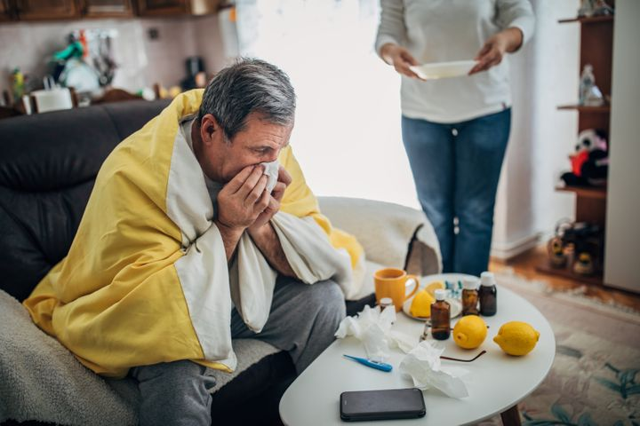 A sick man from a virus is at home
