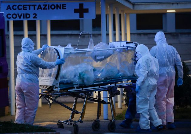 A patient in a biocontainment unit is carried on a stretcher at the Columbus Covid 2 Hospital in Rome...