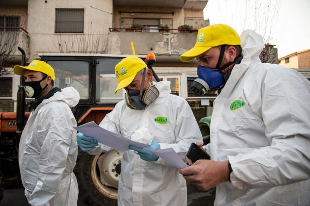 Three volunteers during the briefing of a road disinfection initiative on Thursday in