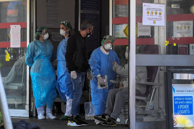NAPLES, CAMPANIA, ITALY - 2020/03/20: Patient whith Coronavirus COVID-19, visited by medic in the Hosital...