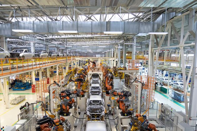 body of car on conveyor Modern Assembly of cars at plant. automated build process of car