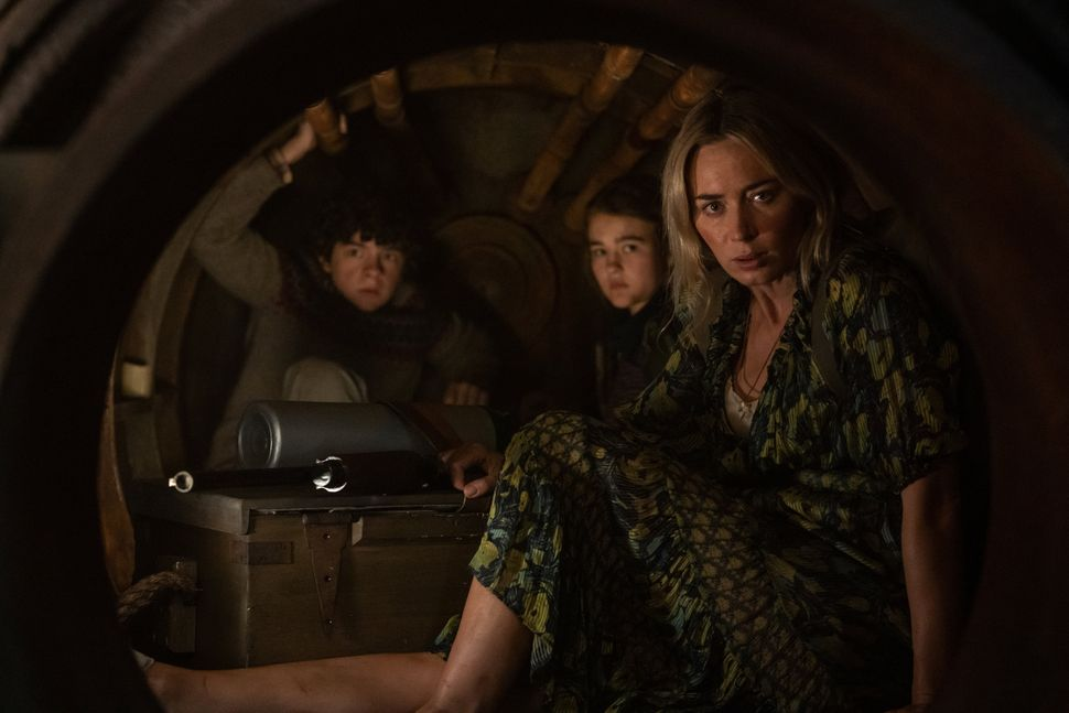 "Noah Jupe, left, Millicent Simmonds and Emily Blunt in ""A Quiet Place Part II."""