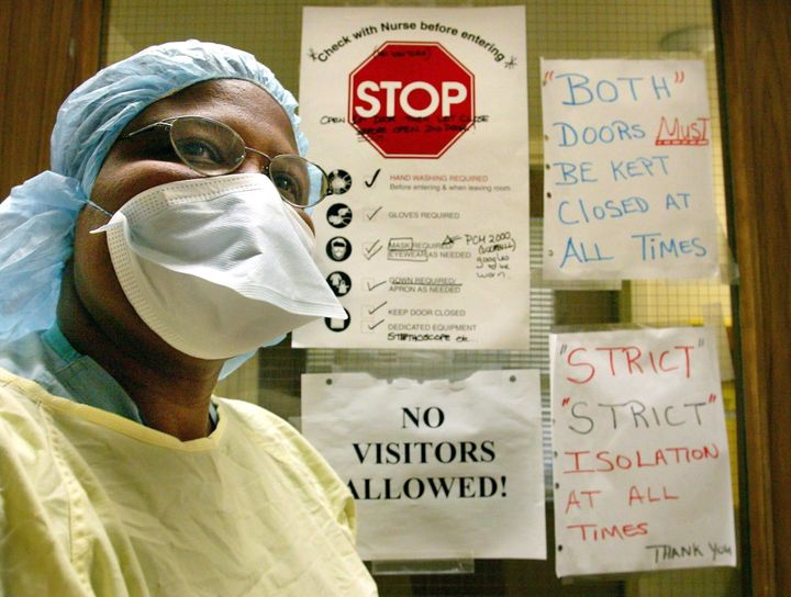 A nurse wears the protective clothing used when treating patients with SARS in Toronto on March 17, 2003.