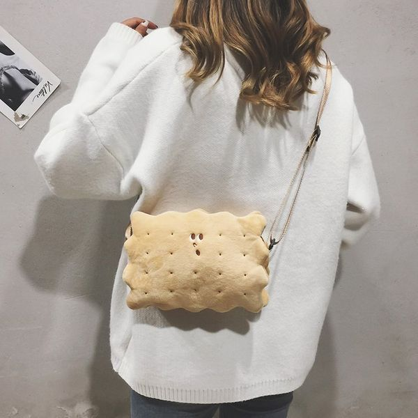 "<a href=""https://theapollobox.com/product/sku839007/plush-biscuit-shoulder-bag-"" target=""_blank"">A purse that looks like a bi"