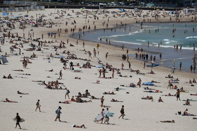 Beachgoers enjoy a sunny day at Bondi Beach despite growing concerns about the spread of the coronavirus...