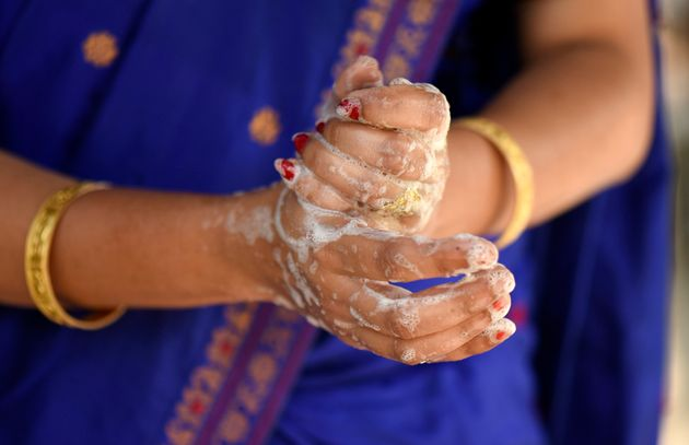 A woman washing her hands as she is protecting herself from Coronavirus, in a village at Barpeta district...