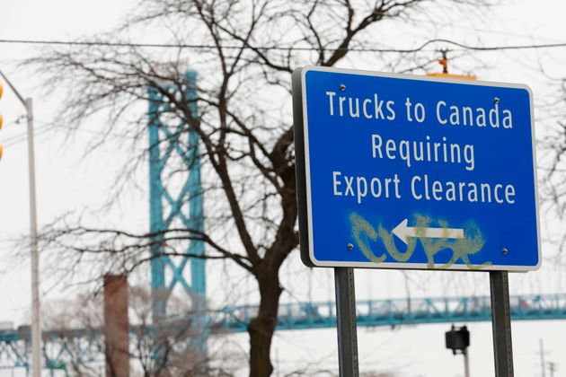 A sign directing trucks to the export clearance site for vehicles cross the Ambassador Bridge from Detroit...