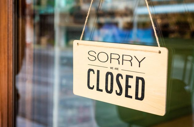 In this stock photo, a closed sign is seen on a restaurant