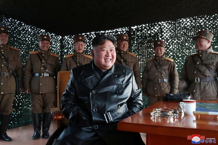 North Korean leader Kim Jong Un smiles after witnessing the firing of what was believed to be two short-range ballistic missi