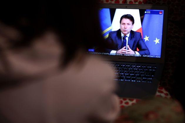 ROME, ITALY - MARCH 21: A girl watches tv as Italian Prime Minister Giuseppe Conte announces the shut...