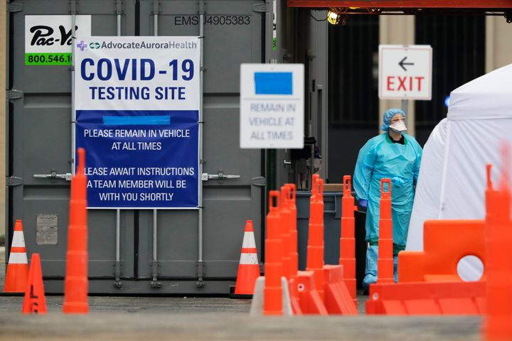 Medical personnel at Advocate Lutheran General Hospital, conduct drive-thru COVID-19 testing in Park Ridge, Ill., Thursday, March 19, 2020. (AP Photo/Nam Y. Huh)
