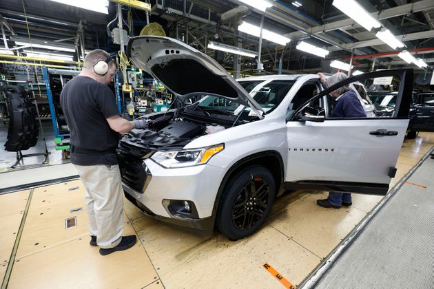 Vehicles go through the assembly line at a General Motors plant inLansing, Michigan, in