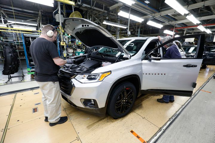 Vehicles go through the assembly line at a General Motors plant inLansing, Michigan, in February.