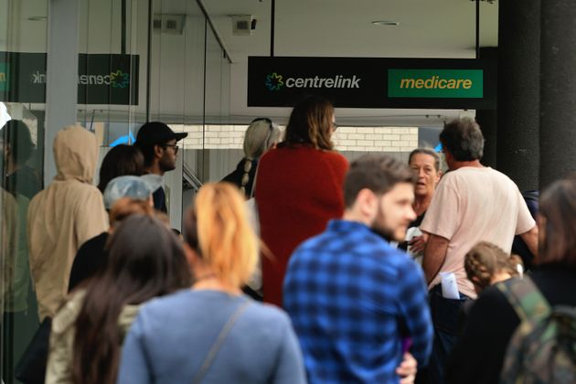 People are seen lining up at Centrelink in Bondi Junction on March 23, 2020 in Sydney, Australia. From...