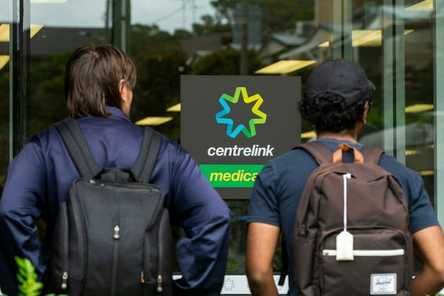 SYDNEY, AUSTRALIA - MARCH 23: People are seen lining up at Centrelink in Bondi Junction on March 23,...