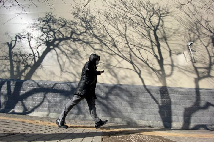 A resident walking in Beijing on Tuesday, March 3, 2020. China's efforts to control the spread of the new coronavirus have sh