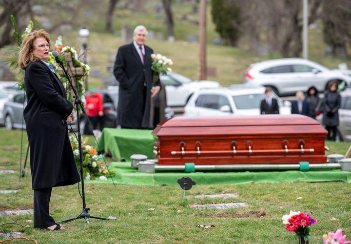 """Terri McDermott speaks during the funeral of her husband Norbert Coyne McDermott III, better known as """"Bert,"""" amid the COVID-"""