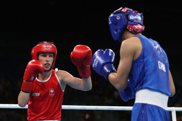 Canada's Mandy Bujold, left, competes in women's boxing at the Olympic Games in Rio de Janeiro on Aug....