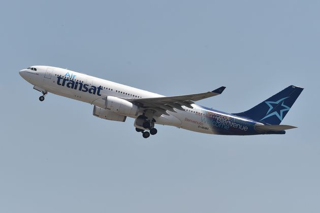 An Air Transat aircraft is seen flying over southern France in July 2018. The Canadian airline says it...