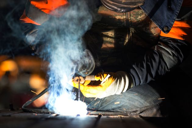 The welder is welding with shielded metal arc welding, manual metal arc welding or stick welding. Electric...