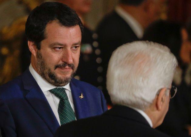 New Italian Interior Minister Matteo Salvini, left, looks at Italian President Sergio Mattarella passing...