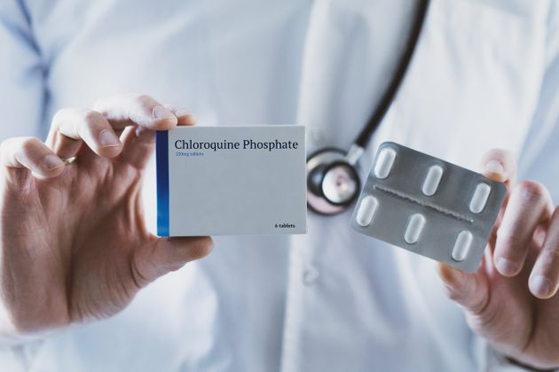 Doctor holding Chloroquine Phosphate