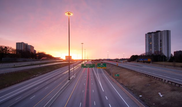 In this stock photo, an empty Highway 401 is seen at dusk in