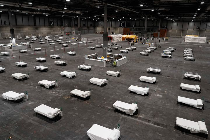 Beds for COVID-19 patients are placed at IFEMA convention center in Madrid.