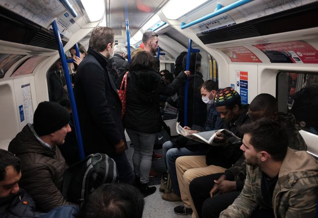 A packed carriage full of passengers travelling on the Victoria line of the London Underground Tube network...