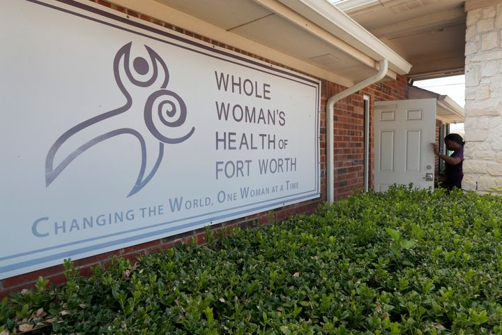 Clinic manager Angelle Harris walks in the front door of the Whole Woman's Health clinic in Fort Worth, Texas, Sept. 4, 2019.